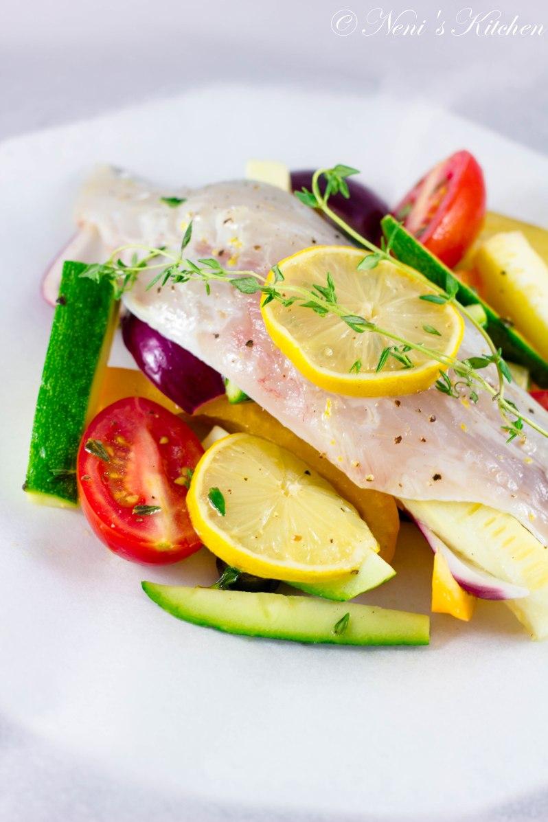fragrant fish in a bag mediterranean veggie bed white wine